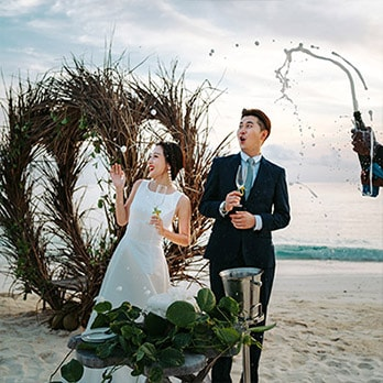 Champagne cork popping at the traditional Maldivian wedding