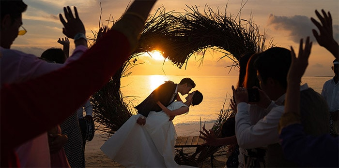A sunset wedding ceremony at the beach