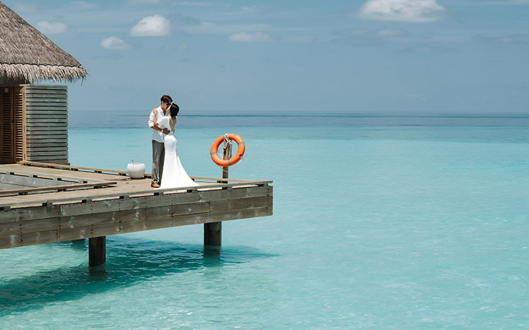 Couple on an overwater terrace