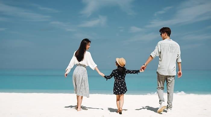 A Family taking a stroll on beach