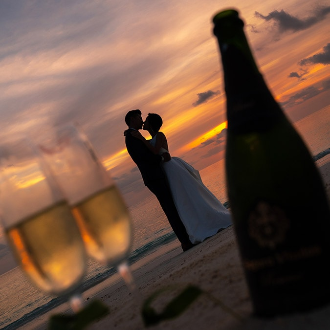 Married couple experiencing a sunset view on the beach