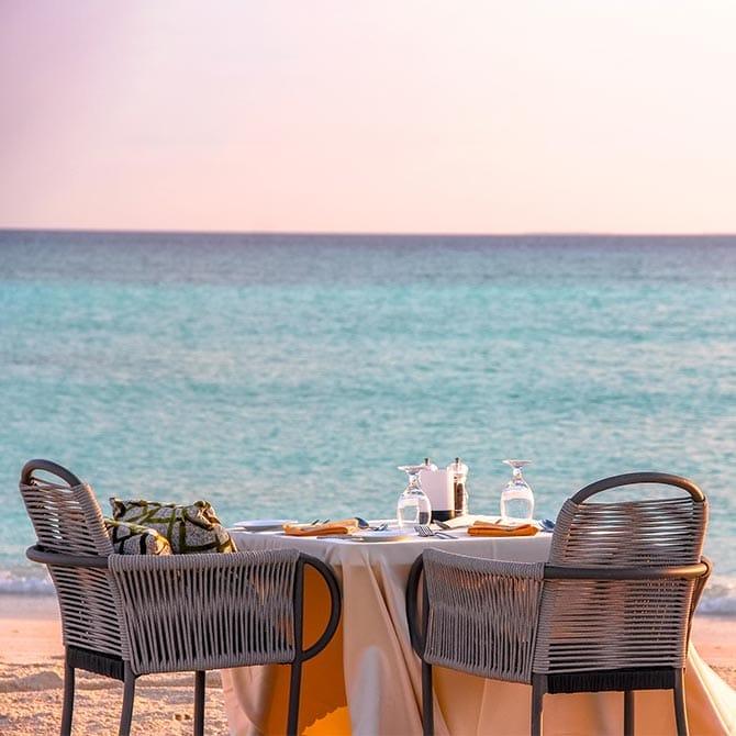 Romantic Beach Dinner setup with an ocean view