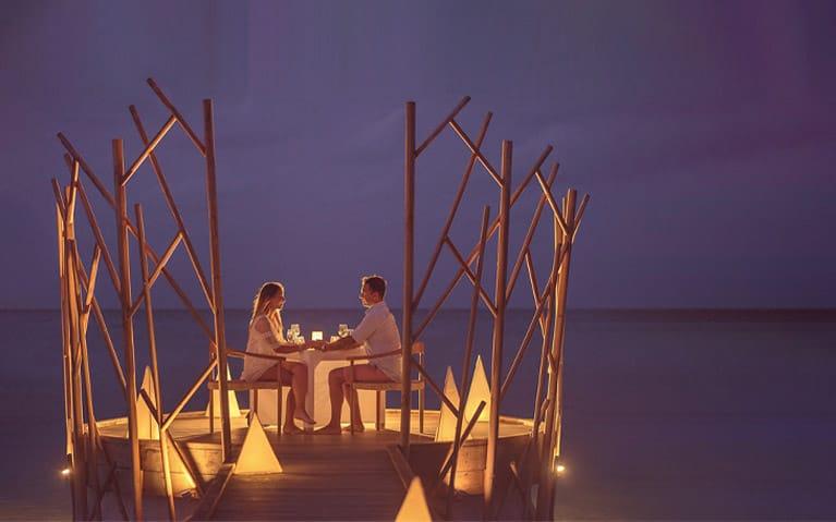A couple enjoying a romantic dinner on the Handhu Platform