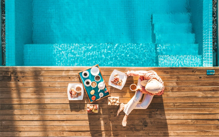 In-villa breakfast served besides the pool
