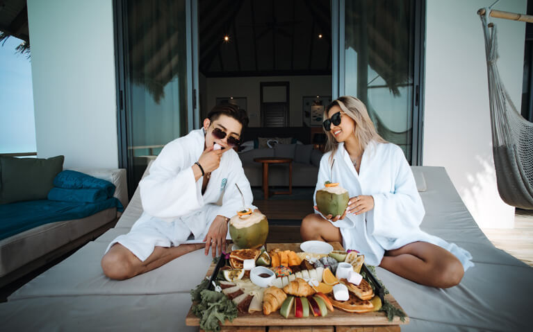 A couple enjoying an in-villa breakfast