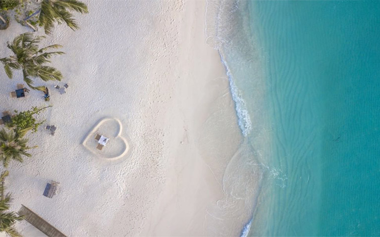Arial View of Romantic Beach Dinner Setup at Fushifaru Maldives