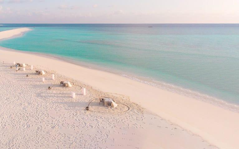 Arial View of Romantic Beach Dinner Setup besides the beach