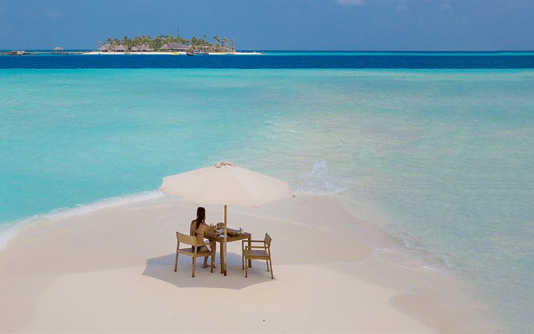 A guest enjoying the private sandbank picnic overviewing the ocean