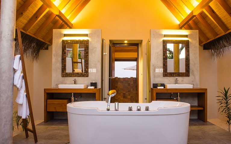 Double vanity bathroom with soaking bathtub